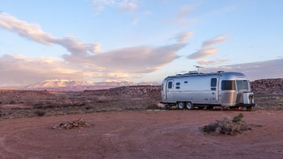 RV in the desert with solar panels
